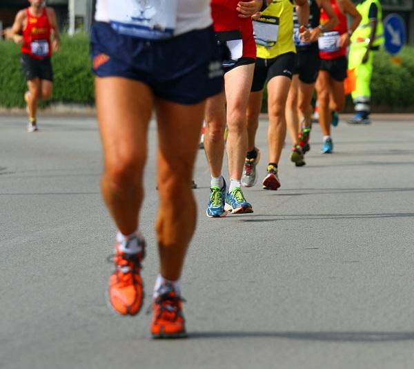 legs of athletes engaged in long international marathon
